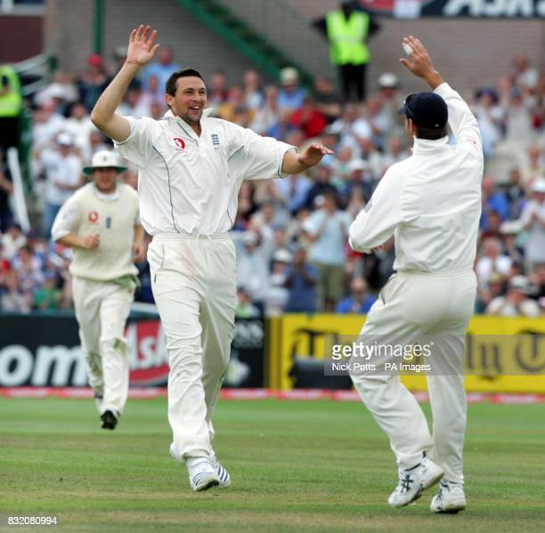England's Steve Harmison celebrates with Marcus Trescothick after taking the wicket of Pakistan's Shahid Afridi during the third day of the second...