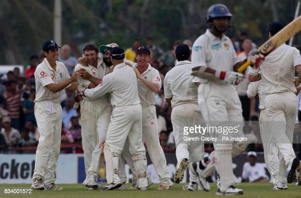 England's Steve Harmison is mobbed by teammates after dismissing Sri Lanka's Kumar Sangakkara during the Third Test Match at Galle International...