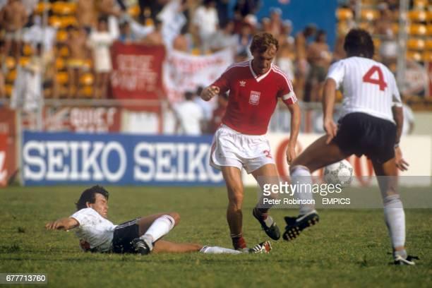 England's Steve Hodge tries to tackle Poland's Zbigniew Boniek