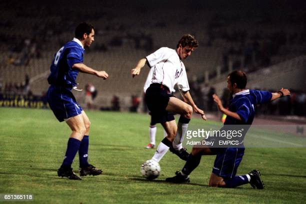 England's Steve McManaman battles with Greece's Angelos Bassinas and Giannis Goumas