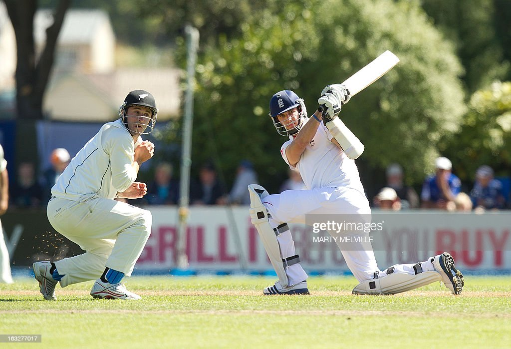 England's Steven Finn bats with New Zealand's Hamish Rutherford fielding during day two of the first international cricket Test match between New Zealand and England played at the University Oval park in Dunedin on March 7, 2013. AFP PHOTO / Marty MELVILLE