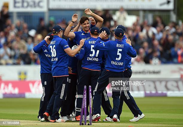 England's Steven Finn celebrates bowling out New Zealand's Brendon McCullum for 6 runs during the fifth one day international cricket match between...