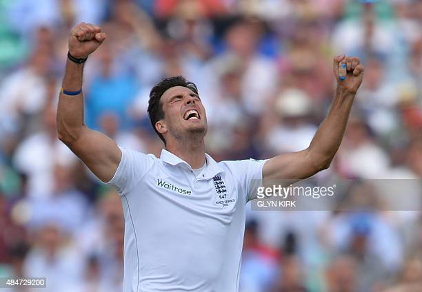 England's Steven Finn celebrates taking the wicket of Australia's Mitchell Marsh on the second day of the fifth Ashes cricket Test match between...