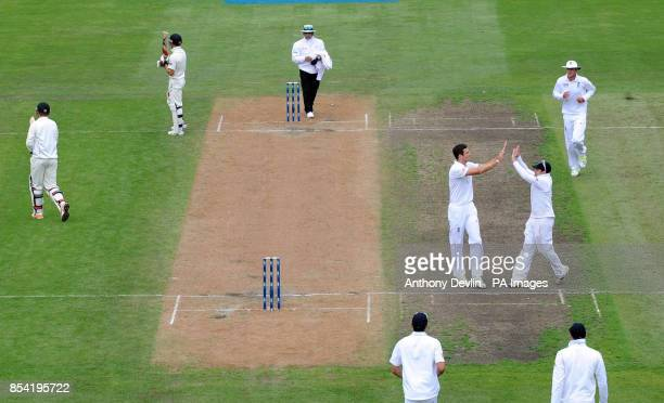 England's Steven Finn celebrates with Ian Bell after taking the wicket of New Zealand's Bruce Martin during Day Four of the First Test at the...