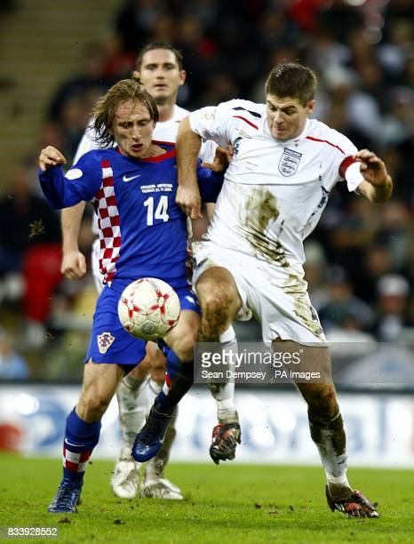 England's Steven Gerrard and Croatia's Luka Modric battle for the ball