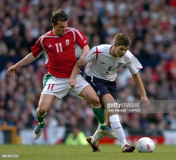 England's Steven Gerrard and Hungary's Sszabolcs Huszti