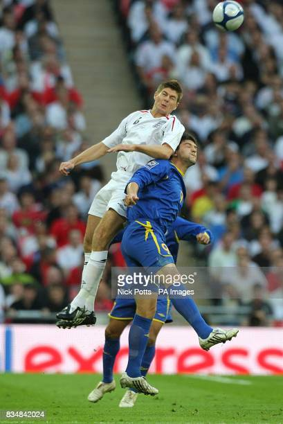 England's Steven Gerrard and Kazakhstan's Sergey Ostapenko battle for the ball