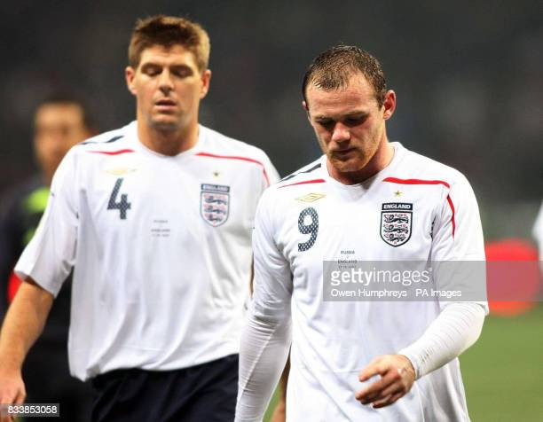 England's Steven Gerrard and Wayne Rooney walk off dejected following the UEFA European Championship qualifying match at the Luzhiniki Stadium Moscow...