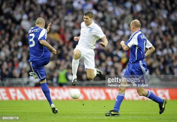 England's Steven Gerrard battles for the ball with Slovakia's Miroslav Karhan and Martin Skrtel