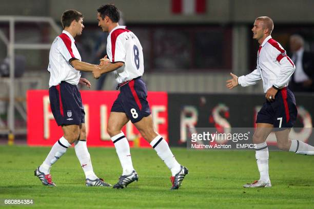 England's Steven Gerrard celebrates scoring with Frank Lampard as captain David Beckham goes to congratulate him
