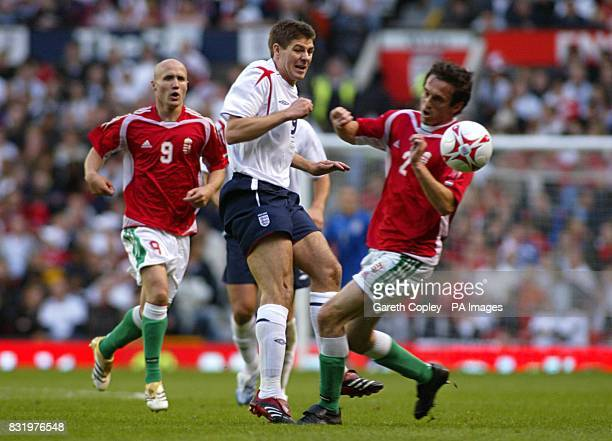 England's Steven Gerrard is challenged by Hungary's Csaba Feher