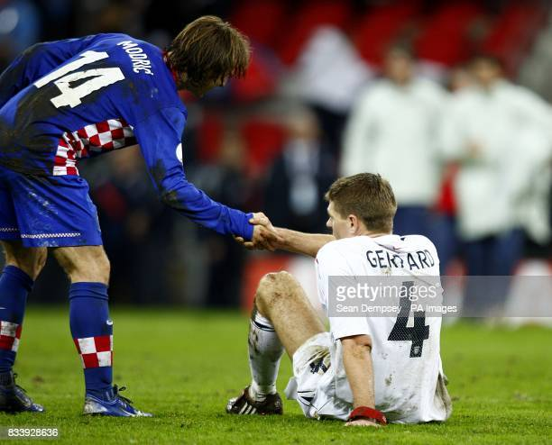England's Steven Gerrard is helped to his feet by Croatia's Luka Modric after the final whistle