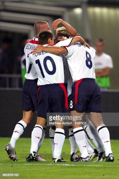 England's Steven Gerrard is mobbed by teammates David Beckham Michael Owen Frank Lampard and Alan Smith after scoring the second goal