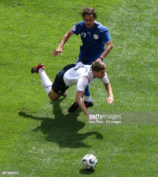 England's Steven Gerrard is tackled by Paraguay's Carlos Paredes during the Group B match at the FIFA World Cup Stadium Frankfurt Germany