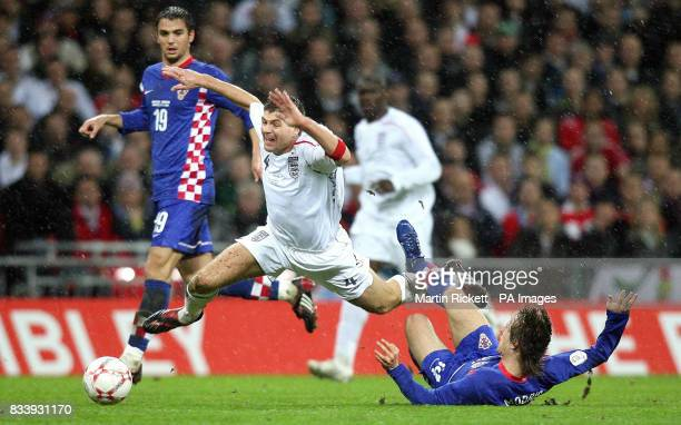 England's Steven Gerrard is tripped by Croatia's Luka Modric during the UEFA European Championship Qualifying match at Wembley Stadium