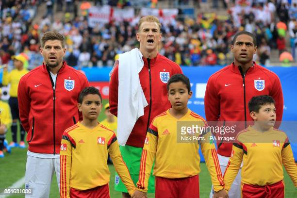 England's Steven Gerrard Joe Hart and Glen Johnson sing the national anthem before the Group D match the Estadio do Sao Paulo Sao Paulo Brazil