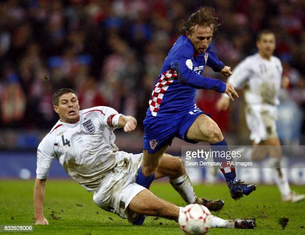 England's Steven Gerrard slides in to make a challenge on Croatia's Luka Modric