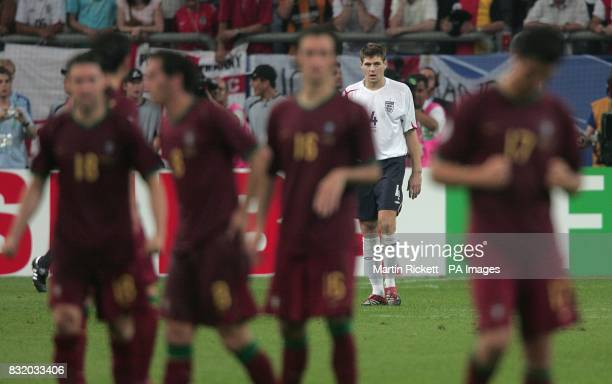 England's Steven Gerrard walks back after having his penalty saved in the shootout