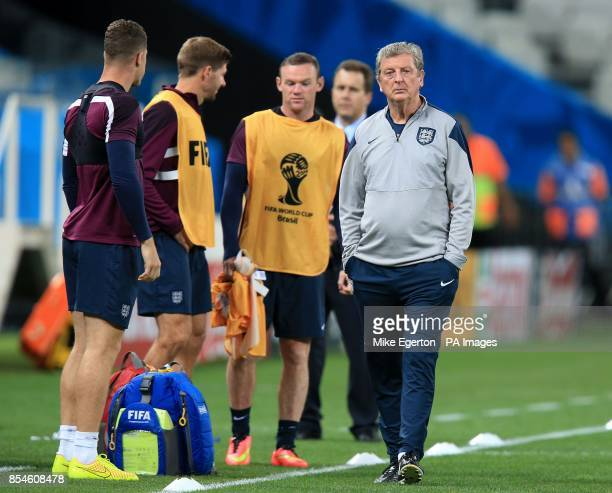 England's Steven Gerrard Wayne Rooney and Roy Hodgson during a training session at the Estadio do Sao Paulo Sao Paulo Brazil