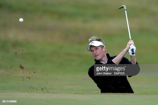 England's Steven Tiley chips out of a bunker during his practice round