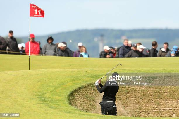 England's Steven Tiley chips out of the bunker during round three of The Open Championship 2010 at St Andrews Fife Scotland
