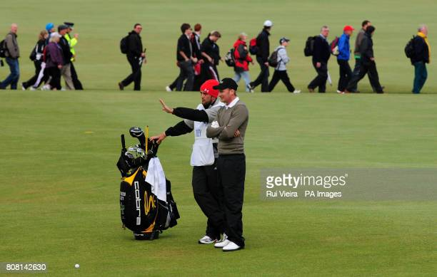 England's Steven Tiley discusses tactics with his caddie Mark Crane as they finish off round two on day three of The Open Championship 2010 at St...