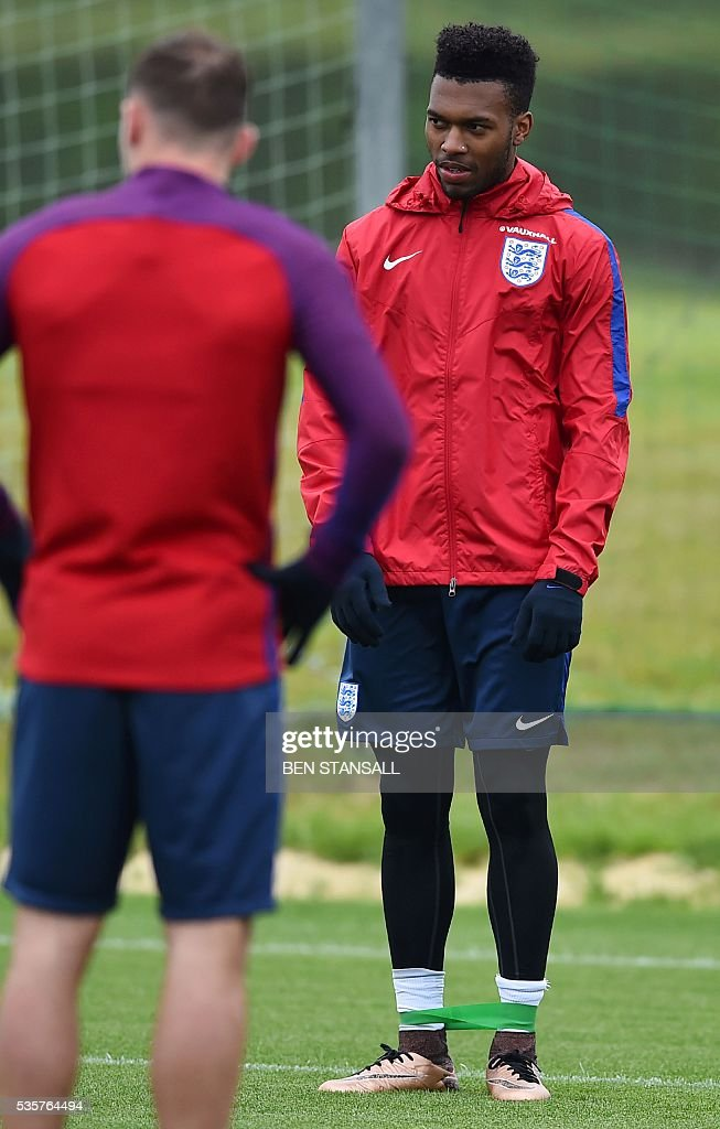 England's striker Daniel Sturridge (R) is pictured as he takes part in a team training session in Watford, north of London, on May 30, 2016. England play against Portugal in a friendly match at London's Wembley Stadium on Thursday June 2, 2016. / AFP / BEN