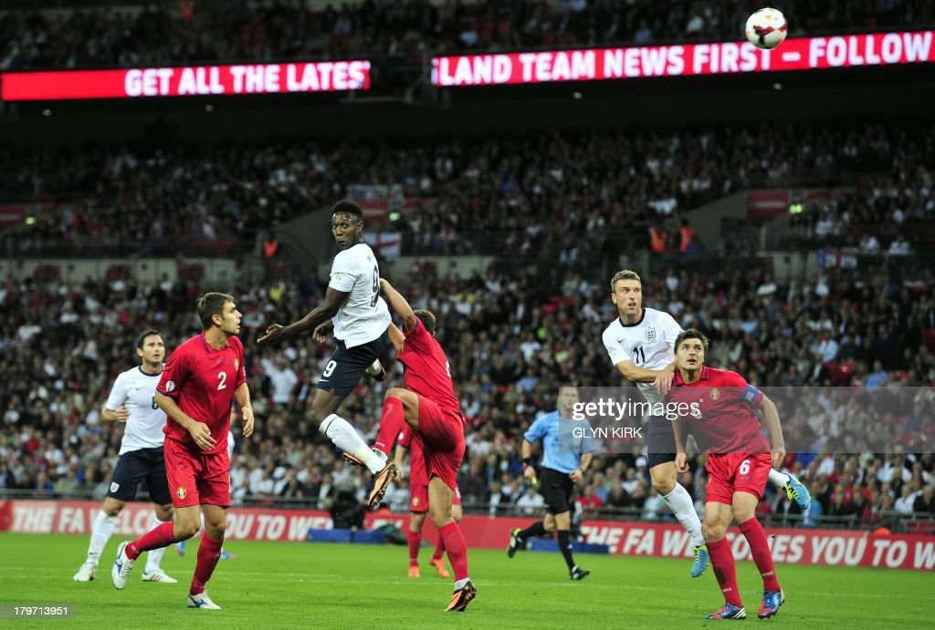 England's striker Danny Welbeck (3rd L) heads the ball towards goal during the World Cup 2014 Group H qualifying football match against Moldova at Wembley Stadium in London on September 6, 2013. AFP PHOTO / GLYN KIRK USE