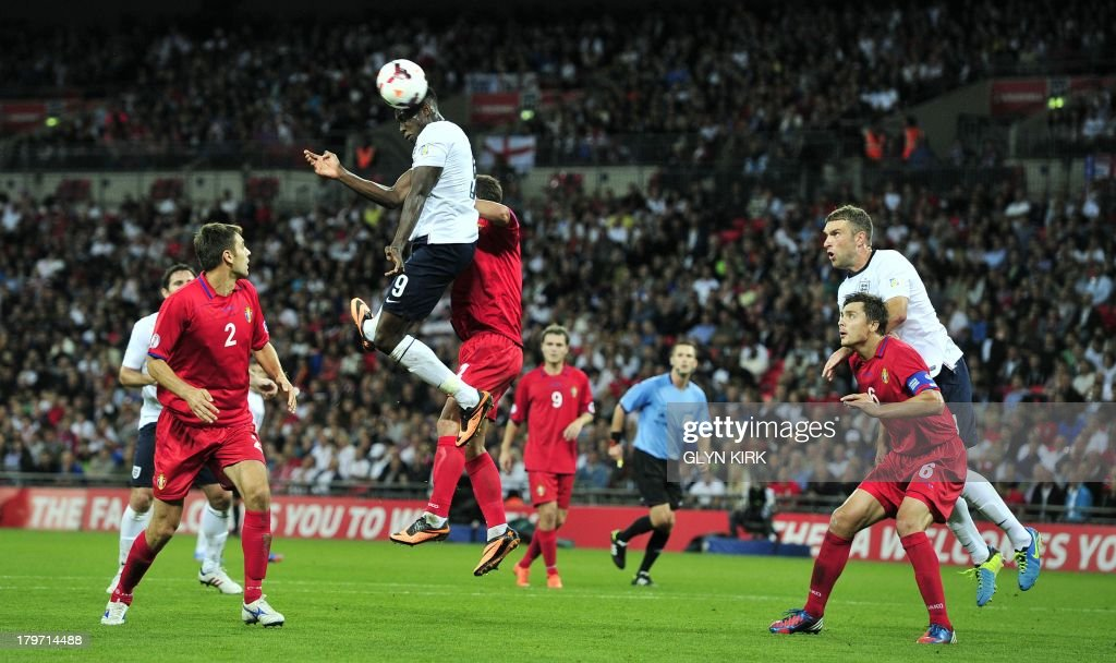 England's striker Danny Welbeck (3rd L) heads the ball towards goal during the World Cup 2014 Group H qualifying football match against Moldova at Wembley Stadium in London, on September 6, 2013.