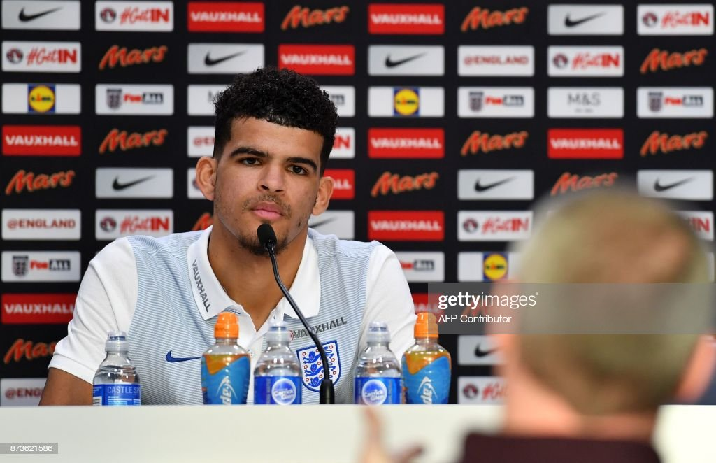 England's striker Dominic Solanke takes questions from members of the media at a press conference at Tottenham Hotspur's Enfield Training Centre, north-east of London, on November 13, 2017 on the eve of their International friendly football match against Brazil. / AFP PHOTO / Ben STANSALL / NOT