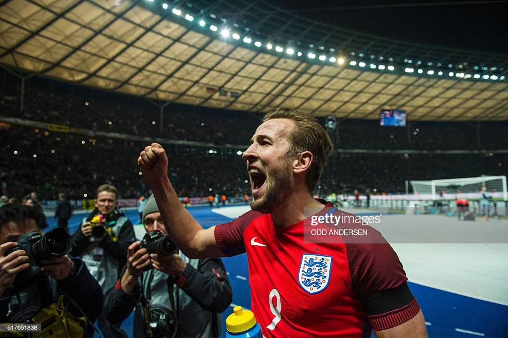 Englands striker Harry Kane acknowledges the travelling fans at the end of the friendly football match Germany v England at the Olympic stadium in Berlin on March 26, 2016. England won the match 2-3. / AFP / ODD