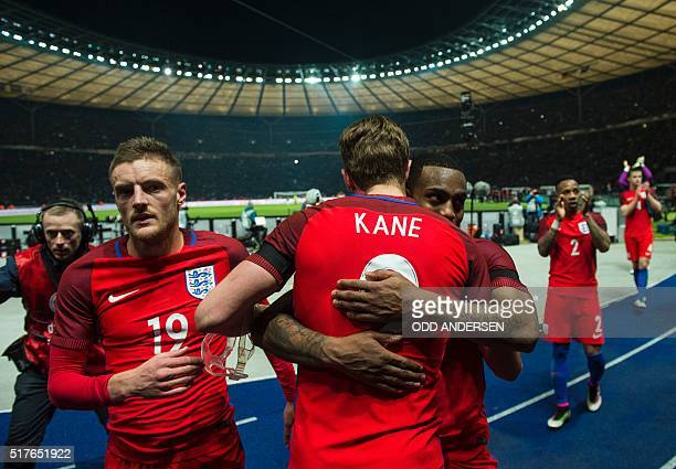 Englands striker Harry Kane embraces Englands defender Danny Rose as they and team mates Englands striker Jamie Vardy Englands defender Nathaniel...