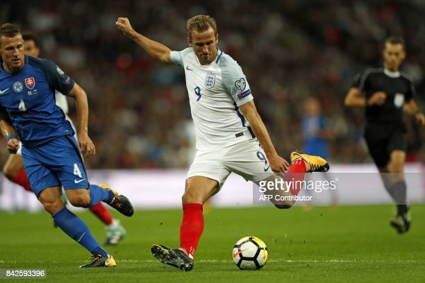 England's striker Harry Kane prepares to shoot during the World Cup 2018 qualification football match between England and Slovakia at Wembley Stadium...