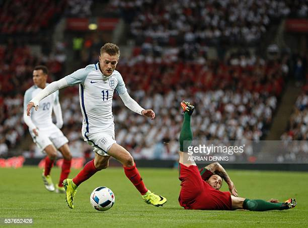 England's striker Jamie Vardy runs with the ball during the friendly football match between England and Portugal at Wembley stadium in London on June...