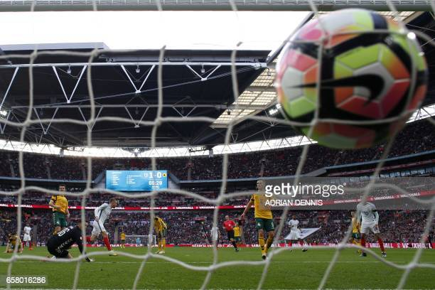England's striker Jamie Vardy turns to celebrate his goal as the ball strikes the back of the net during the World Cup 2018 qualification football...