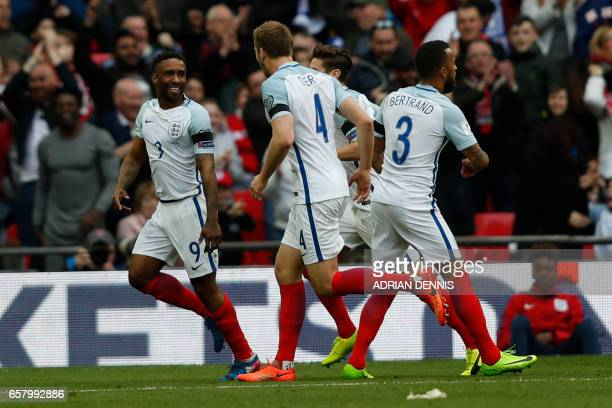 England's striker Jermain Defoe celebrates with teammates after scoring his team's first goal during the World Cup 2018 qualification football match...