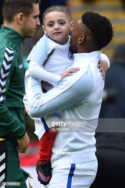 England's striker Jermain Defoe holds Bradley Lowery a fiveyearold suffering from terminal cancer mascot for the match ahead of the World Cup 2018...