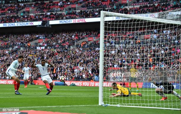 England's striker Jermain Defoe scores his team's first goal during the World Cup 2018 qualification football match between England and Lithuania at...