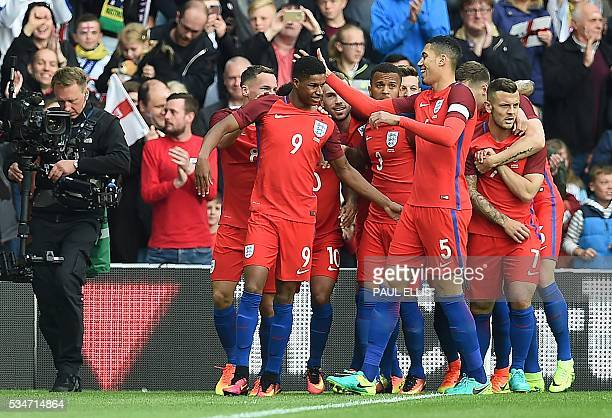 England's striker Marcus Rashford celebrates after scoring his team's first goal during the International friendly football match between England and...