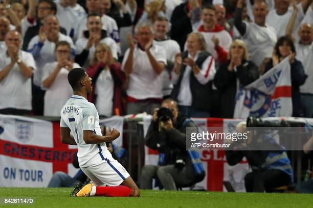 England's striker Marcus Rashford celebrates scoring England's second goal during the World Cup 2018 qualification football match between England and...