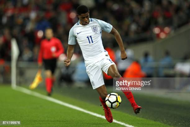 England's striker Marcus Rashford controls the ball during the international friendly football match between England and Brazil at Wembley Stadium in...