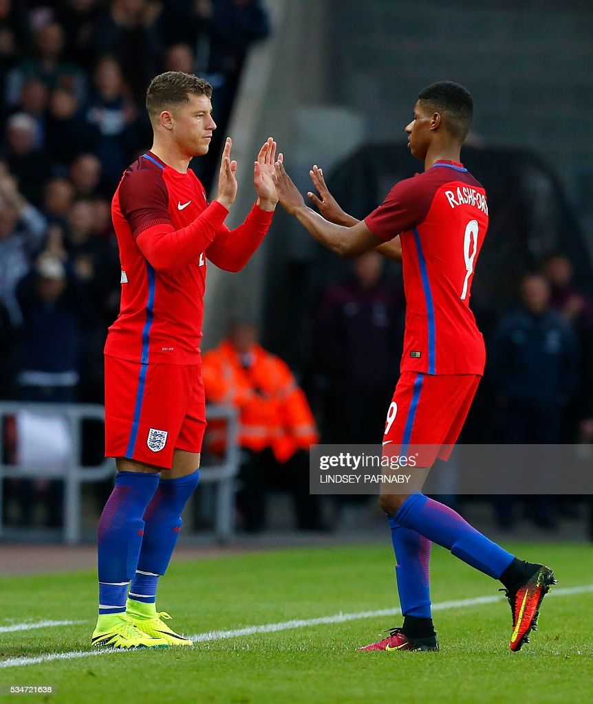 England's striker Marcus Rashford (R) is substituted by England's midfielder Ross Barkley during the friendly football match between England and Australia at the Stadium of Light in Sunderland, north east England, on May 27, 2016. / AFP / Lindsey PARNABY / NOT