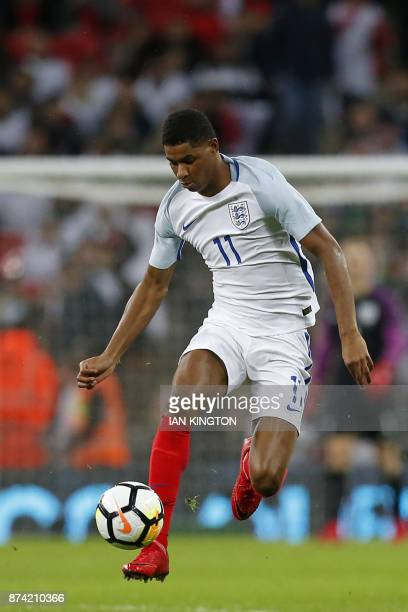 England's striker Marcus Rashford runs with the ball during the international friendly football match between England and Brazil at Wembley Stadium...