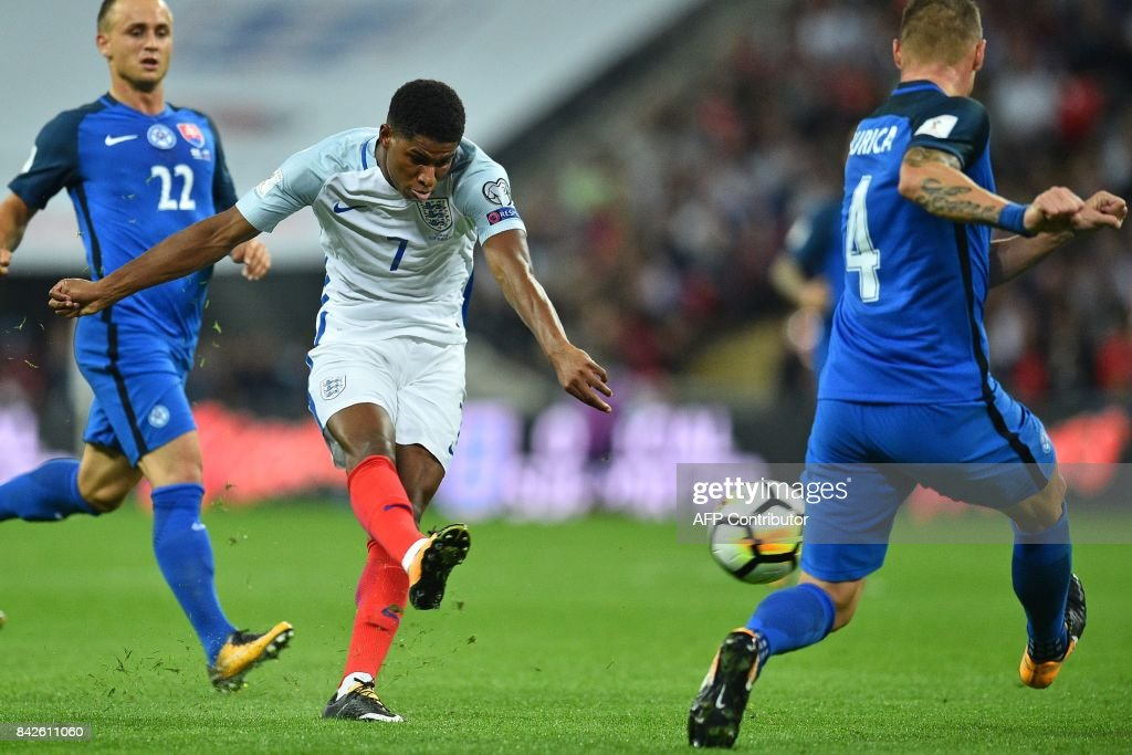 England's striker Marcus Rashford shoots to score England's second goal during the World Cup 2018 qualification football match between England and Slovakia at Wembley Stadium in London on September 4, 2017. / AFP PHOTO / Glyn KIRK / NOT