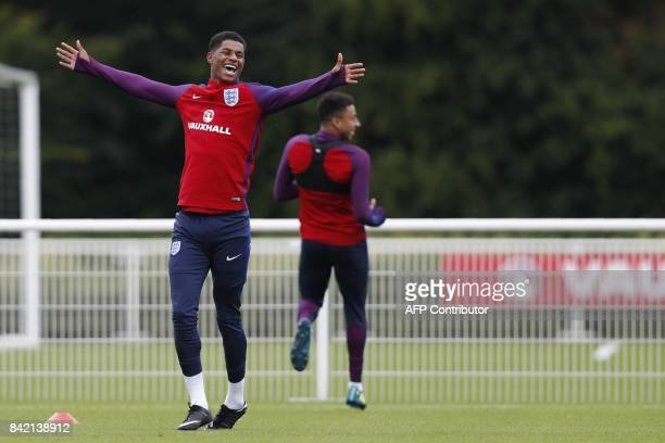 England's striker Marcus Rashford smiles as he takes part in an England team training session at Tottenham Hotspur's training ground in north London...