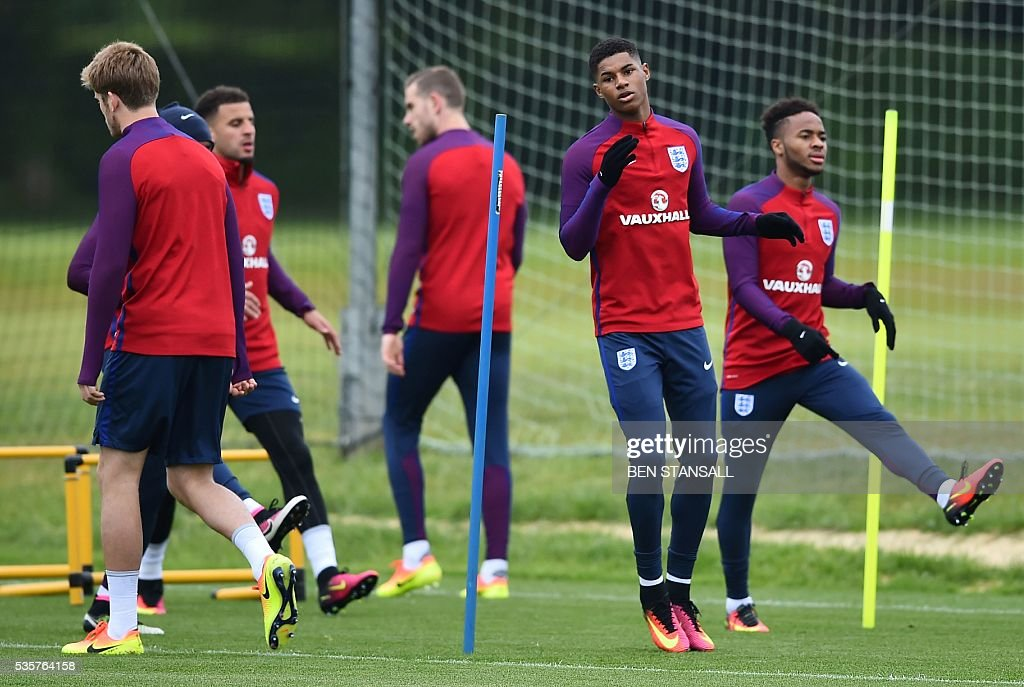 England's striker Marcus Rashford (2nd R) takes part in a team training session in Watford, north of London, on May 30, 2016. England play against Portugal in a friendly match at London's Wembley Stadium on Thursday June 2, 2016. / AFP / BEN