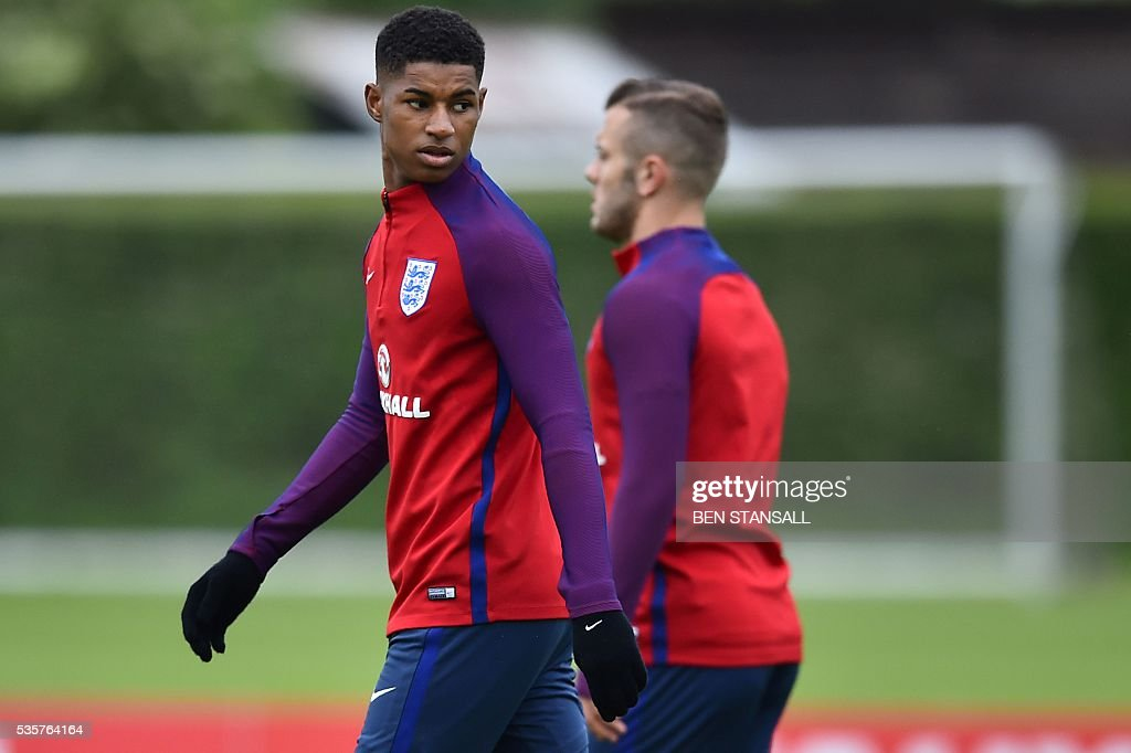 England's striker Marcus Rashford (L) takes part in a team training session in Watford, north of London, on May 30, 2016. England play against Portugal in a friendly match at London's Wembley Stadium on Thursday June 2, 2016. / AFP / BEN