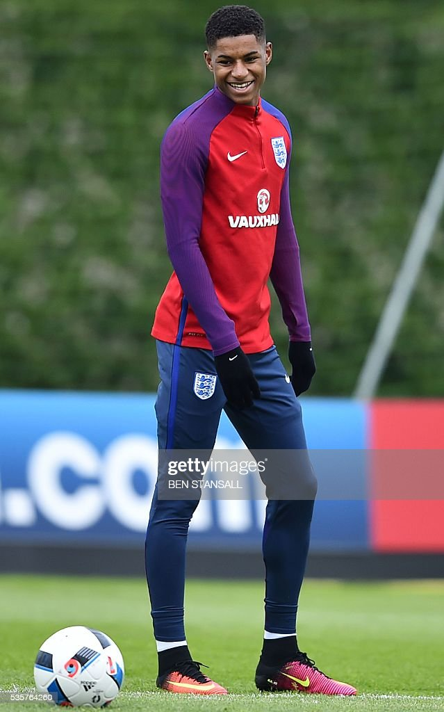 England's striker Marcus Rashford takes part in a team training session in Watford, north of London, on May 30, 2016. England play against Portugal in a friendly match at London's Wembley Stadium on Thursday June 2, 2016. / AFP / BEN