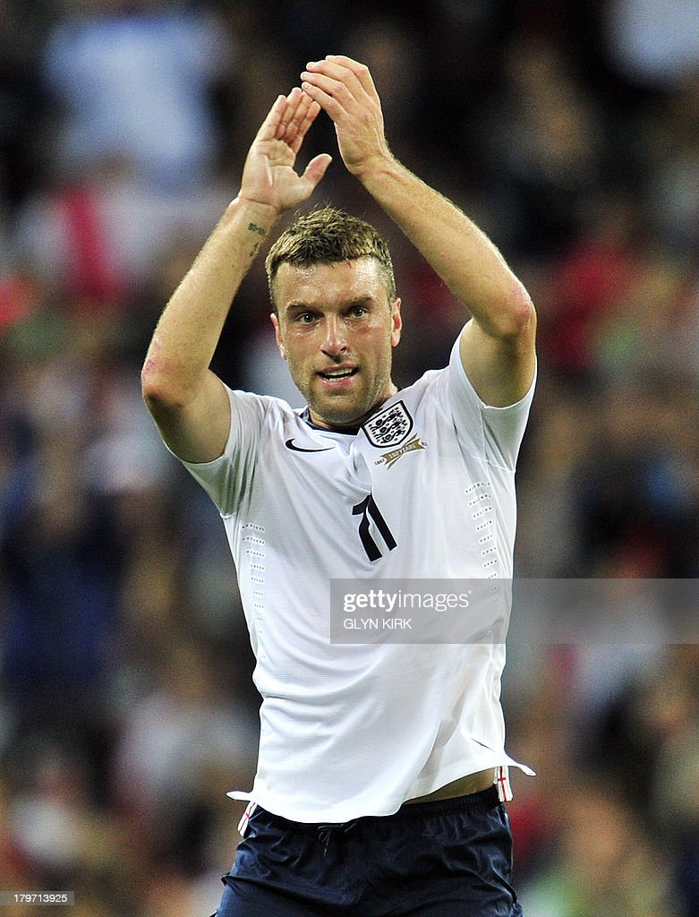 England's striker Rickie Lambert acknowledges the fans applause after being substituted during the World Cup 2014 Group H qualifying football match against Moldova at Wembley Stadium in London on September 6, 2013.