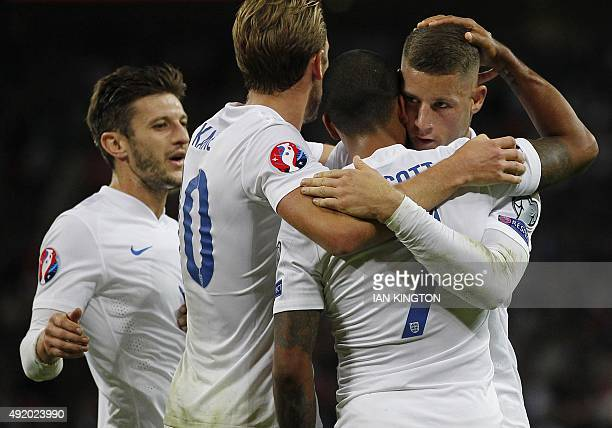England's striker Theo Walcott is congratulated by Ross Barkley Harry Kane and Adam Lallana after he scored his team's first goal during the Euro...